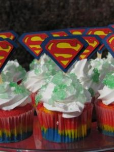 Not only do they have blue, yellow, and red filling, they also have green stuff on them. That's supposed to be Kryptonite. So Superman probably can't eat these, even if it's his own birthday.