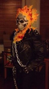 He's somewhat of a supernatural biker with flaming hair. Sure he's frightening to look at. But he seems so badass.