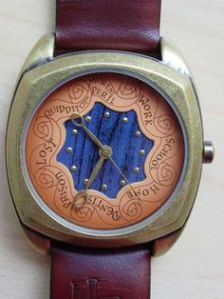 I'm sure Mrs. Weasley has to have a watch like this. Well, this one just tells the time. But it's clever nonetheless.