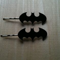They're just bobbie pins with the bat symbol on them. Not sure if Batgirl would wear them though.