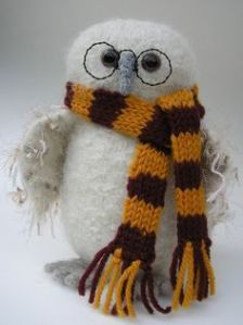 Yes, it's another stuffed Hedwig. But this one has Harry Potter glasses and a Gryffindor scarf.