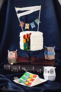 And as you see, this cake may have white icing. But it has all the Hogwarts house colors inside.
