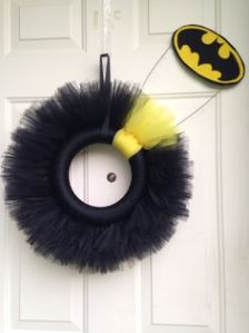 I think the construct around this wreath is quite clever. Like how the bat signal is tilted so it can seem like it's a shadow.
