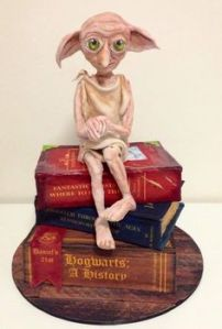 Dobby likes seeing a cake in his likeness. Dobby thinks the maker is too kind. Dobby is in tears.