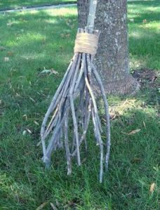 This one just consists of wrapping twigs on big stick with packing tape. Seems doable if you ask me.