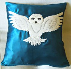 It's just a bright blue cushion pillow with a snowy owl on it. But I'm sure any Potter fan would adore this.
