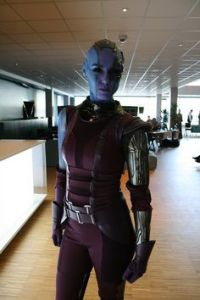 Her original comic appearances depict her with hair. In the movie Guardians of the Galaxy, she's bald.