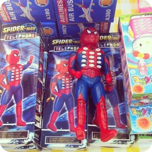 And I thought the toy Spidey cell phone was ridiculous. This one has you dial on Spider Man's body. Wonder how he'd react when you push his buttons.