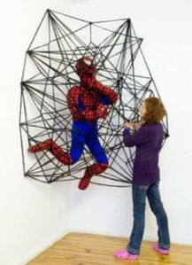 I think this is a crochet art display in an art museum. Still, want to know how Spider Man will get out of this one.