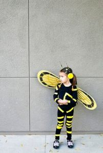 It's a little girl who's dressed like Wasp from the original Avengers. She's not the Avengers movie. But she's in Ant-Man. Also, she can fly as well as shrink, too.
