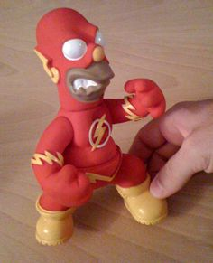 Now the Flash can move in super high speeds with the aid of beer and donuts. Okay, could anyone possibly think that Homer would make a good Flash? D'oh!
