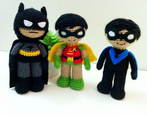 Consist of Batman, Robin, and Nightwing. And all of them are so super adorable if you ask me.