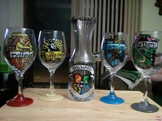 The carafe has the Hogwarts crest on it. The glasses represent a house. Makes a great commemorative set.