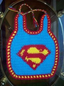 Yes, it's a crocheted Superman bib that goes with a Superman hat. And yes, it's adorable.