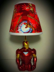 Seems like it's an Iron Man action figure with a lampshade on top. Then again, the lampshade does match the suit.