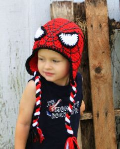 Sure it has some black, white, and red tassles on the side. But it sure looks cute on that kid.