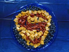 This one consists of baby hot dogs, cheese, and blueberries. Still, you have to appreciate this.