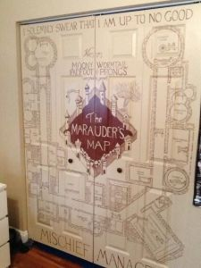 The Marauder's Map also tells you where people are at all times. Yet, I suppose this door was painted like the map by someone with too much time on their hands.