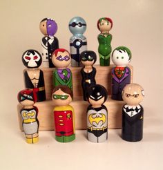Includes Batman, Robin, Batgirl, and Alfred along with Rogues Gallery members Bane, Riddler, Catwoman, Joker, Two Face, Mr. Freeze, and Poison Ivy. Nevertheless, these are all adorable.