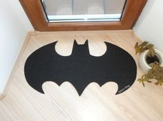 It's the kind of rug that welcomes friends and strikes fear into enemies. Like the bat sign in Gotham City.