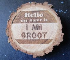 I think this a wood carving that was featured on Etsy. Love how it uses the name tag format.