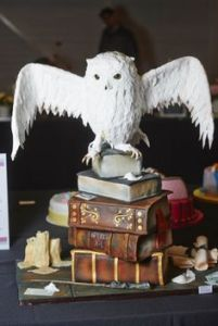 Let's hope Hedwig didn't leave a little present for Harry on that stack of books. Then again, Hedwig's bowel movements don't seemed to be discussed much in the series.