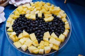 These consist of pineapple and blueberries. Still, it certainly bears a good resemblance to the Batman symbol.