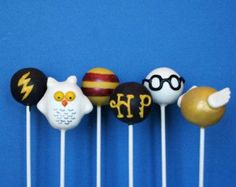 These are cake pops that pertain to Harry Potter. These consist of a lightning bolt, Hedwig, Gryffindor colors, HP, Harry's glasses, and the Golden Snitch.