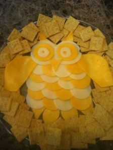 Sure this owl may be a bit white and yellow. But it sure looks tasty being surrounded by crackers.