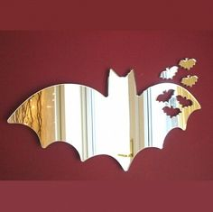 It's a mirror that's shaped like a bat and has other bats on it. Nevertheless, you can't help but like it.