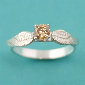 Guys, unless she insists on a ring like a golden snitch, don't get her one. Even if she likes Harry Potter. Also, costs $155.