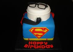 This is a Clark Kent/Superman cake. Apparently, Metropolis residents don't see the association between the 2 other than in looks.