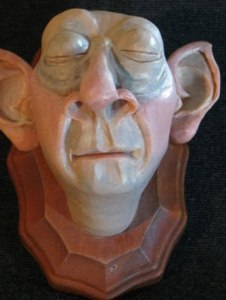 Sure it's not Dobby. But this doesn't make the house elf head display less disturbing.