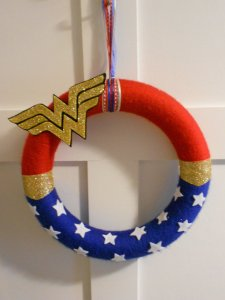This wreath contains stars and the Wonder Woman symbol. All in all it should be great for any home.