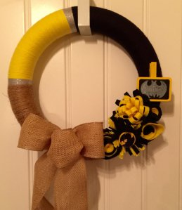 This one seems to contain black and gold ribbons. Take the bat symbol off and it becomes a Pittsburgh Steelers wreath.