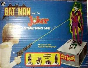"From the Robot's Voice: ""It's clear the good people at Vanity Fair were not comic readers when they made a Batman version of their popular cowboy target game. The concept has you, as Batman, shooting the Joker dead with a revolver. Whether you want to turn yourself into the police or toss yourself off a ledge in the Batcave for breaking your one, solemn rule is entirely up to you."""