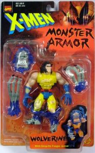 "From The Robot's Voice: ""I'm not sure exactly what function this ""armor"" serves. Do the big, hairy boots protect against the cold? Does the fright mask scare off Morlocks? Do the giant grey fingers protect Woverine's claws against tarnishing? Whatever the reason, the fully ""armored"" Wolverine looks more like a member of Gwar then any toy I've ever seen — which must have something to do with the fact that the head sculpt underneath looks a lot like Glenn Danzig."""