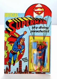 Why the hell does Superman need a parachute? He can fly and land safely land on his feet on his own. This toy doesn't make sense at all.