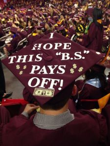 "As you'll see, some grads decorate their caps in unique ways. I suppose ""B.S."" either stands for bullshit or Bachelor in Science."