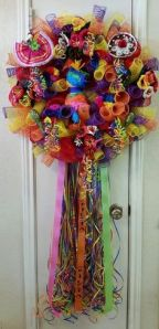 I have to admit, this is a lovely fiesta wreath. Like the pinata in the center.