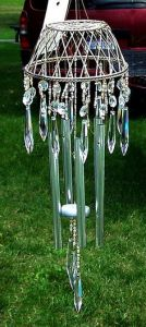 Apparently, you can make a rather cool wind chime with a basket. Simply breathtakingly lovely.