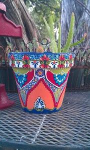 Well, the cacti and this flower pot give it a real Mexican feel. Love how it's painted.