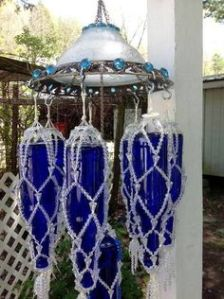 Kind of resembles a flying saucers with large bottles attached in a bead mesh. But it's a wind chime and a rather large one at that.