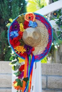 This one is covered in flowers and is used as an outdoor decoration. Love the ribbons, too. So pretty.