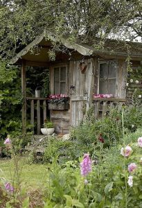 Yes, it looks as if it's an abandoned shack in a garden. Well, if it weren't for the blooming flowers.