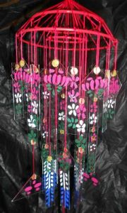 These seem to be painted in flowers and they seem suspended on some kind of cage. Or that's as far as I see.