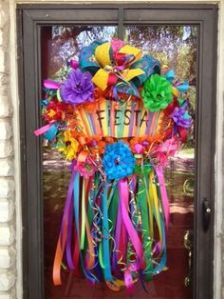 "Because it says ""fiesta"" on the wreath. And it's decorated in bright colors, flowers, and ribbons."