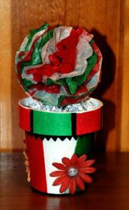 This is a painted flower pot in Mexican flag colors. Like the tissue paper flower on the top.
