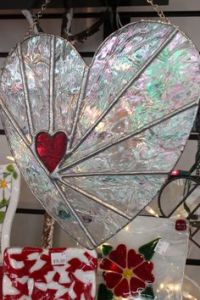 Maybe not but it sure looks like it. Nevertheless, you have to love this heart suncatcher design.