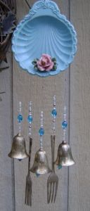 You tend to see a lot of cutlerly in wind chimes. Not sure if it enhances the aesthetic or brings out the sound.